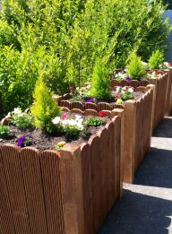 Large wood-stained planter-boxes